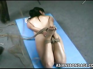 Asian lass is hanging around during her bdsm