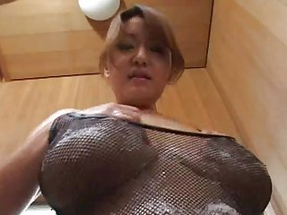 Asian big tits porn star giving a tit massage