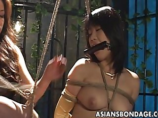 Bound Asian chick endures a nasty BDSM threes