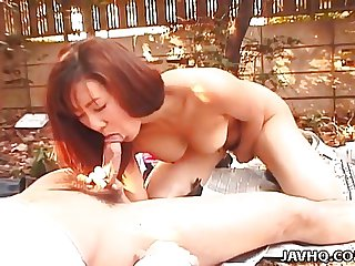 Asian babe is fucked in the garden on some pa