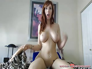 Sexy pale girl sitting on big toy