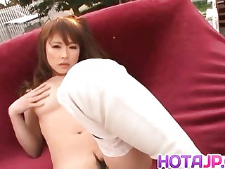 Yuu arouses her pussy and nipples outdoor
