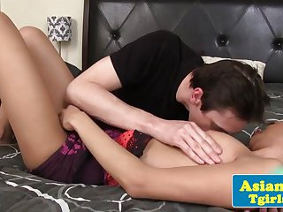 Assfucked asian shemale jerkingoff with male