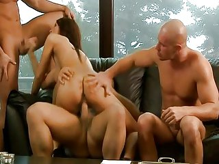 Hot brunette surprised by three cocks