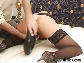 Busty brunette fisted and giant dildo fucked