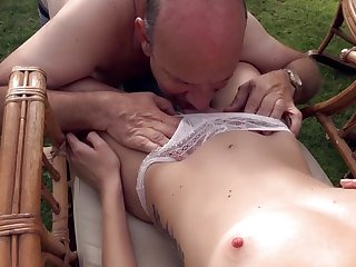 Teen nympho is sucking bulky old dong outdoor
