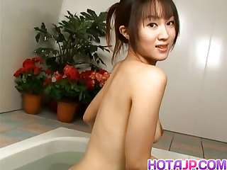 Ai kurosawa fondles her tits and rubs pussy