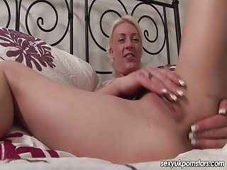 UK blonde in college uniform plays with pussy