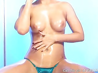 Cali Garcia covered in oil & being naughty