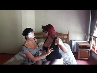 2 Sexy Mask Girls Playing On The Bed