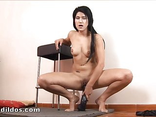 Teen slut fills her pussy with a brutal dildo